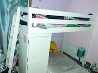white wooden bunk bed with cabinet