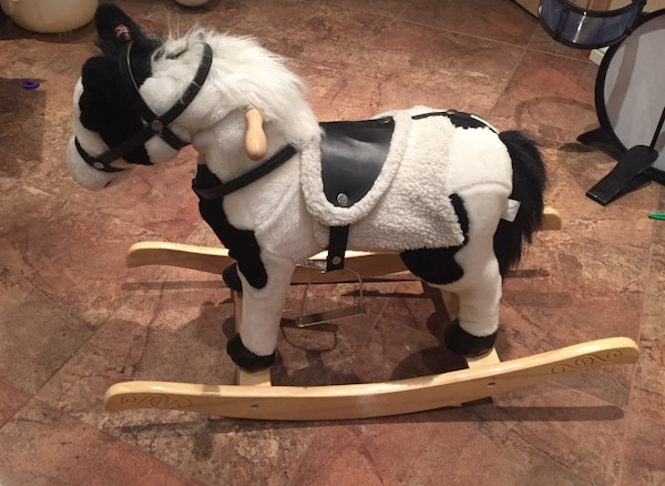 white and black rocking horse toy