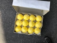 12-piece yellow dimpled softballs for pitching machine  Woodbine, 21797