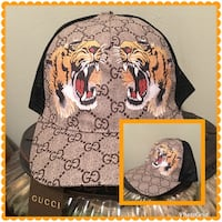 Monogrammed gucci and two brown lion graphic trucker cap Port Saint Lucie, 34953
