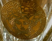 Pair of glasses with Medusa Versace decoration.