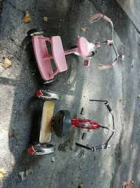 toddler's two pink and red trike