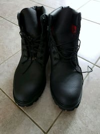 pair of black leather work boots Toronto, M8Y 0A9