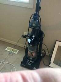 black and blue upright vacuum cleaner
