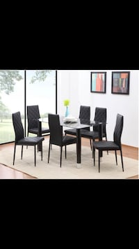 Glass table with 6 chairs for only 299