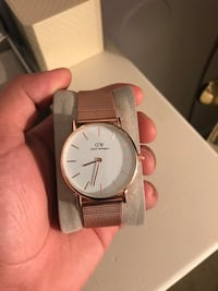 round gold-colored Daniel Wellington analog watch with link bracelet