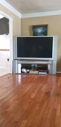 Toshiba 65' television with gray wooden TV stand Woodbridge, 22193