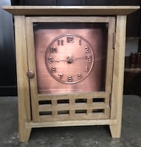 brown wooden dresser clock