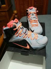 pair of gray-and-black Nike basketball shoes with