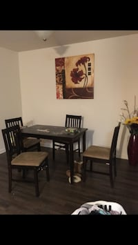Rectangular brown wooden table with four chairs dining set Cedar Rapids, 52405