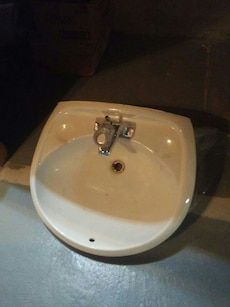 white granite sink with faucet