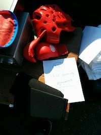 pair of red boxing gloves and head protector Whitby