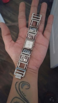 white face analog watch with silver link bracelet