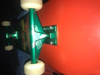 red and black Toy Machine skateboard