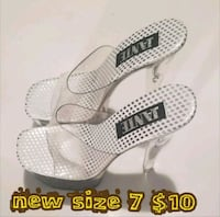 pair of white leather open-toe wedge sandals Las Vegas, 89169