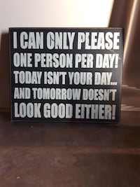 black wooden board with text print