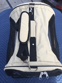 white and black pet carrier