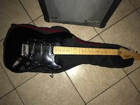Squier by fender stratocaster with amplifier. Los Angeles, 91605