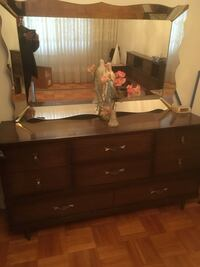 Brown wooden dresser with mirror and two night tables and another 4 drawer set Montréal, H1L