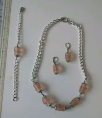 silver and gold necklace and earrings