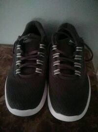 pair of black-and-white running shoes St. Louis, 63138