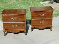 two brown wooden 2-drawer chests