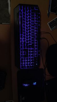 Black and blue computer keyboard and mouse.  Kelowna, V1W 4W3