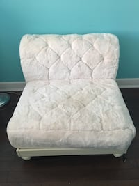 Pottery Barn's Girls faux fur chair. Chair with base. Off white like new smoke free home. Price firm.  Lake Grove, 11755