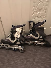 Pair of black-and-gray inline skates New Westminster, V3L 3H5