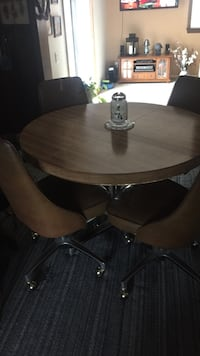 Brown wooden round dining table set