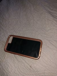 gold iPhone 6 with brown case Donna, 78537