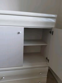 Closet with two drawers.