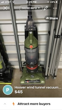 Green and black upright vacuum cleaner