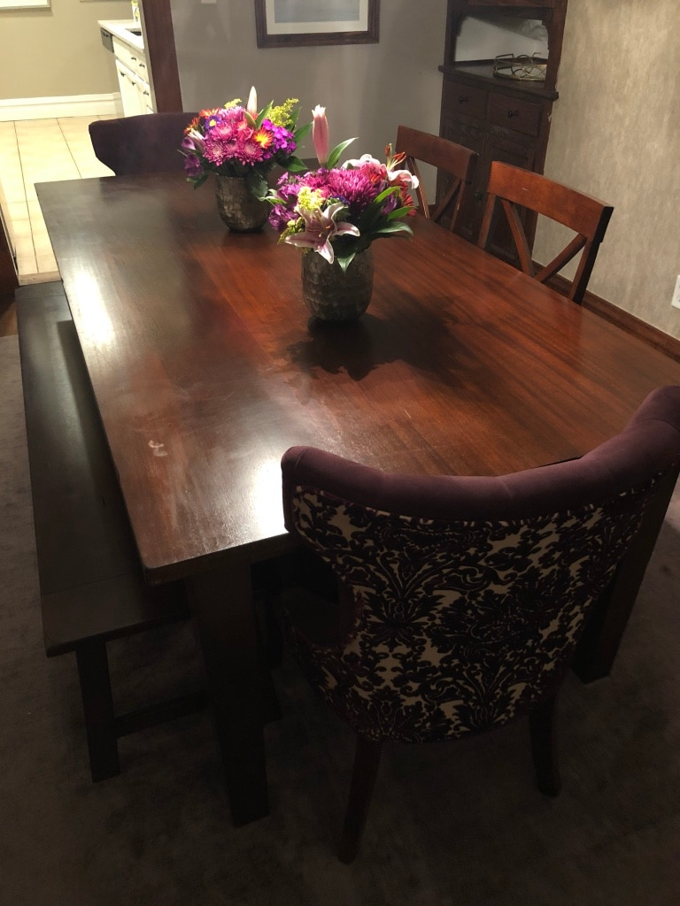 Photo Pier 1 dining table with two chairs and a bench