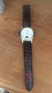 round silver analog watch with black leather strap London, N15 3AU