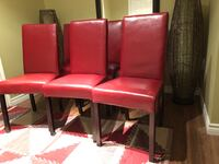 two red leather padded chairs Pickering, L1V 1T3
