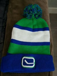 blue and green striped Canucks hat  Langley, V3A 1S2