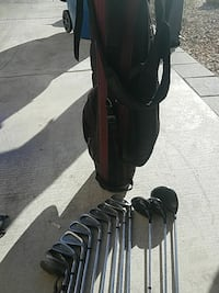 black golf bag with silver golf iron lot