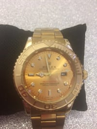 Round gold-colored rolex analog watch with link bracelet Brentwood, CM14 5LD