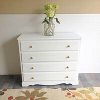 "‪Dresser Chest Of Drawers Painted White Clear Wax Sealer with Gold  Knobs Solid Wood Four Drawers ‬  ‪Great condition‬ Measures 40"" L x 35"" W x 16"" D  ‪Pick up only in Cumming ‬ Read Less Cumming, 30041"