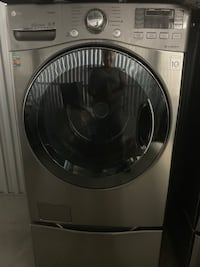 LG-4.5 Cu ft front load washer/dryer with 2 storage pedestals graphite steel Lightly Used TURBO WASH Silver Spring, 20910