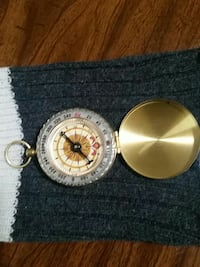 brass-colored and white compass Surrey