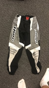 gray, white, and black Thor motorcycle pants