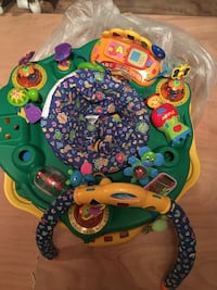 Green yellow and blue multicolored exersaucer