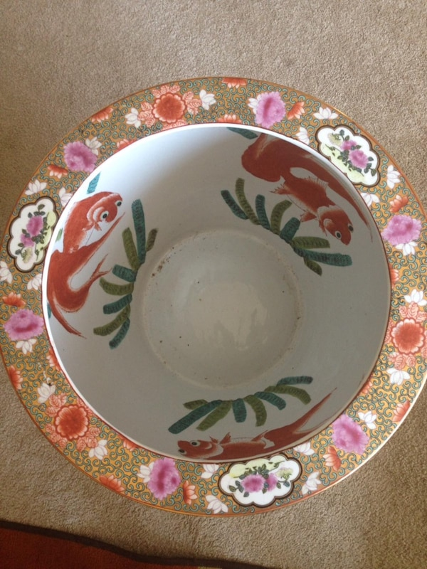 white and red ceramic plate