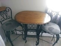 round brown wooden table with two chairs Ottawa, K1G 3P8