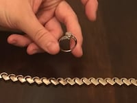 silver-colored bypass ring