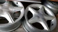 silver 4-spoke automotive rims