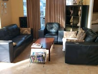 two black leather sofa chairs 3731 km