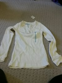 white and brown long-sleeved shirt 550 km